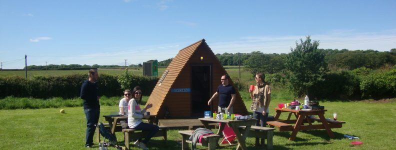 Family outside wigwam